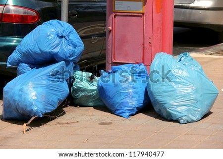 Garbage bags on the street - stock photo