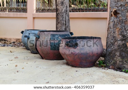 garbage bin made from old rubber tires on public road ,thailand  - stock photo