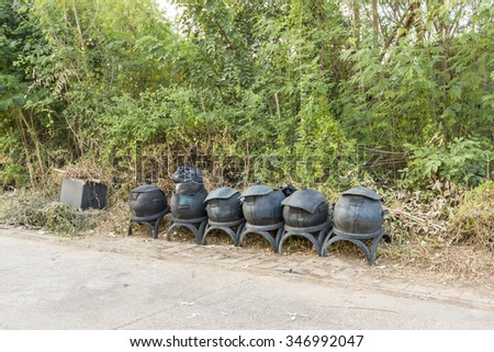 garbage bin made from old rubber tires on public road - thailand recycle rubber tire for green bin - stock photo