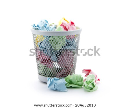 garbage bin with colorful paper waste isolated on white background - stock photo