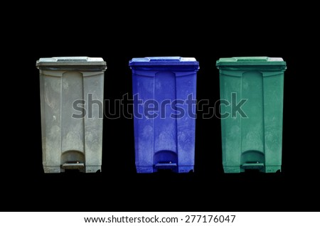 Garbage can on black background - stock photo