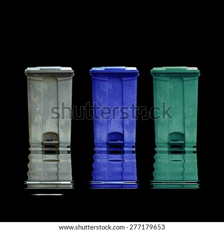 Garbage can with reflect on black background - stock photo