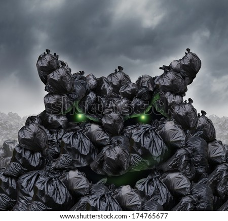 Garbage monster at a dump as mountains of black trash bags with an unpleasant smell shaped as an evil character with glowing green eyes and bad breath in a landfill heap of environmental damage. - stock photo