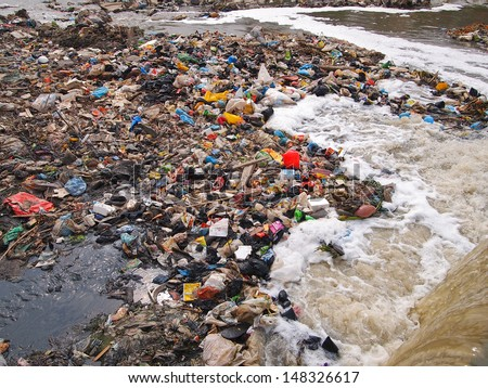 Garbage on the river shore - stock photo