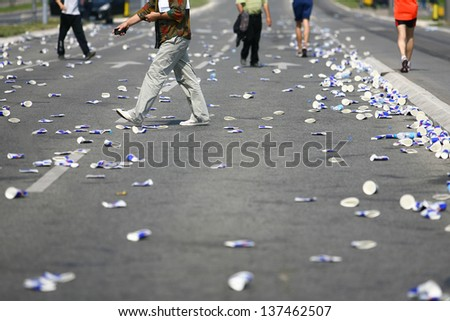 Garbage on the streets after athletic race - stock photo