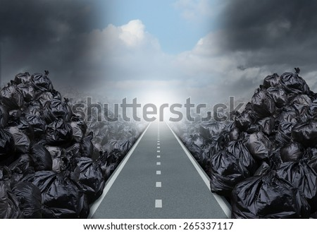 Garbage solution environmental concept as a straight road or clear path cutting through a background with garbage bags as a symbol for global waste management hope for the future. - stock photo