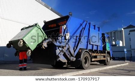 garbage transport car loading itself  - stock photo