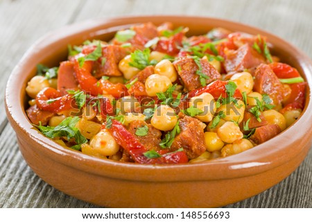Garbanzos y Chorizo - Chickpeas and spicy sausage with red peppers tapas. Traditional Spanish dish. - stock photo