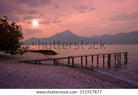 garda lake beach in romantic moonlight scenery - stock photo