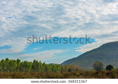 Garden and clouds with blue sky - stock photo