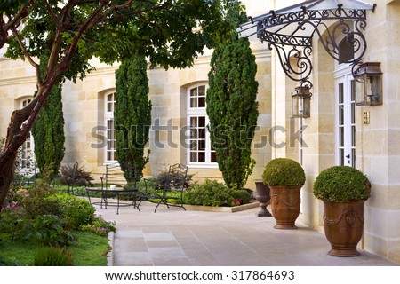 Garden and terrace of a luxury French mansion near Bordeaux - stock photo