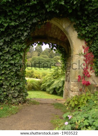 Garden archway of old stone - stock photo