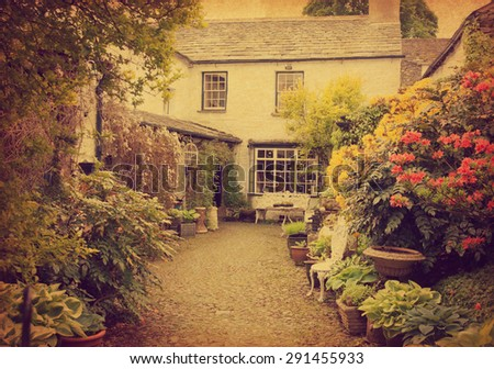 Garden at the front of  old house, Lake District, Cumbria, UK.  Photo in retro style.  Added paper texture. - stock photo