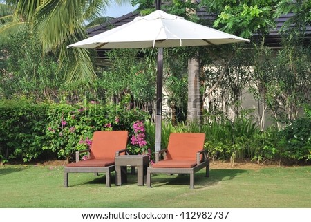 Garden beds and umbrella - stock photo