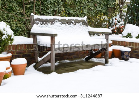 Garden bench in snow - stock photo