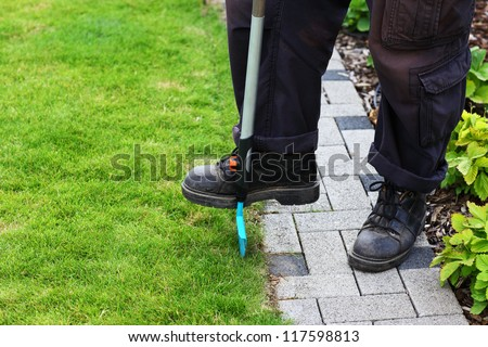 Garden care - edging lawn - stock photo