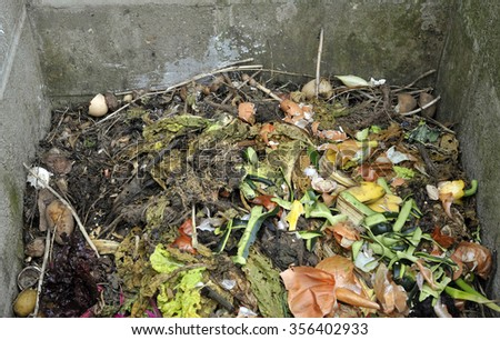 Garden compost heap with vegetable and kitchen food waste. - stock photo