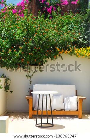 Garden Courtyard with beautiful flowers. Crete, Greece - stock photo