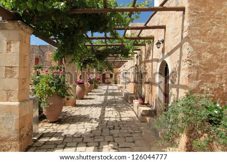 Garden Courtyard with flowers in ceramic pots, images from Monastery of Arkadi, Crete, Greece - stock photo