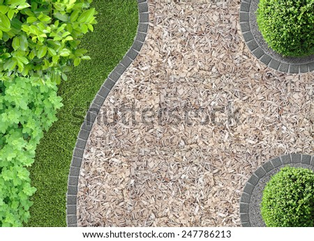 garden detail in aerial view with chaff path - stock photo