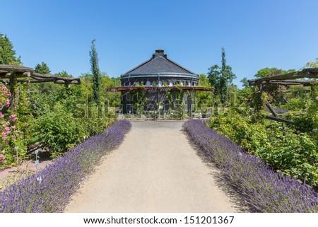 Garden house in an ornamental garden - stock photo