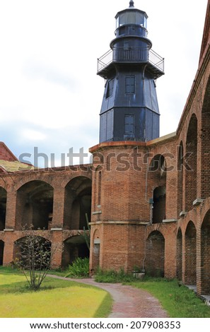 Garden Key Light was moved to its perch atop a bastion at Fort Jefferson in 1876 - stock photo