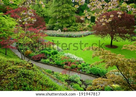 garden landscape in spring, victoria, british columbia, canada - stock photo