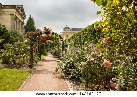 Garden of roses in the Jardin de Plant in Paris,  France. Eastern part of the garden with it's beautiful rose archways in June. - stock photo