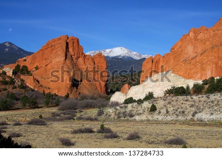 Garden of the Gods in Colorado Springs - red sandstone formations with Pikes Peak in background. - stock photo