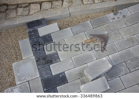 garden path construction with concrete slabs in two colors - stock photo