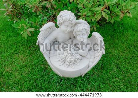 "Garden sculpture ""Two little angels dream"" - stock photo"