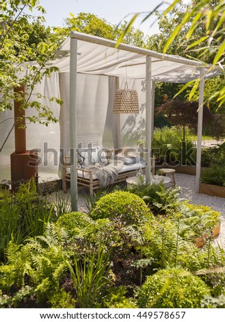 Garden seating area with bamboo furniture.  - stock photo