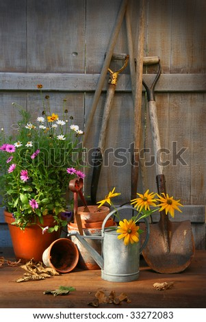 Garden shed with tools and flower pots - stock photo