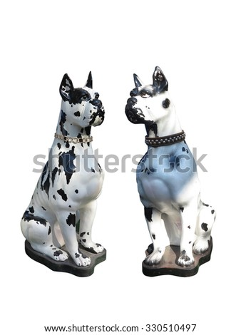 Garden statue of two dogs isolated over white background - stock photo