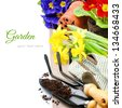 Garden tools and colorful flowers isolated over white - stock photo