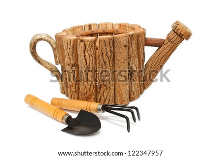 Garden tools and wood flower pot on white background - stock photo