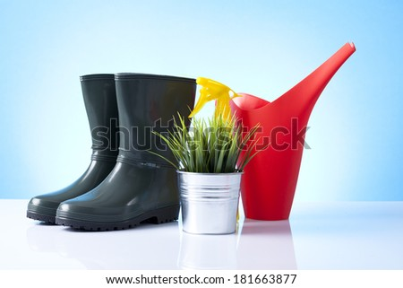 Garden tools isolated on blue - stock photo
