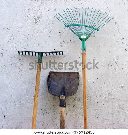 Garden tools. shovel, rake, broom foliage - stock photo