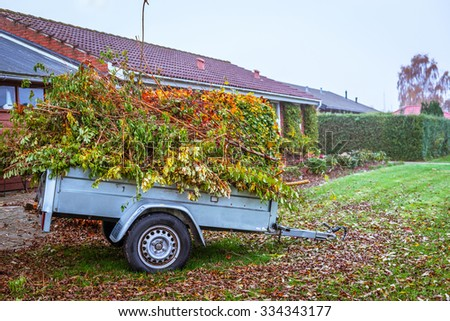 Garden waste in a wagon in the autumn - stock photo