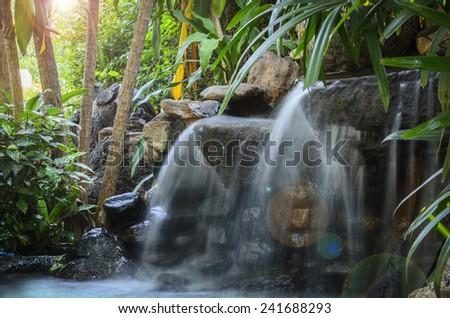 Garden waterfall - stock photo