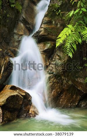 Garden Waterfalls with slow shutter. - stock photo