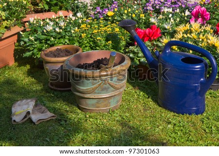 Garden with autumn flowers in September - Planting new plants in flowerpots and -boxes - stock photo