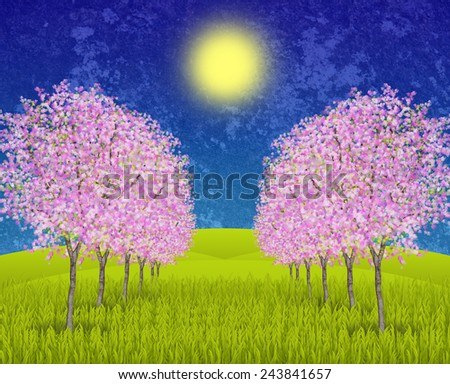 Garden with blooming apple tree in a parkway at noon with the sun shining at a blue sky - stock photo