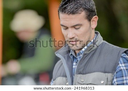 Gardener deep in thought - stock photo