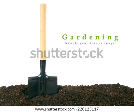 Gardening. A shovel in the earth. - stock photo