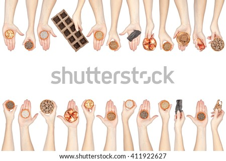 gardening. collection of planting and seeding supplies in a hands isolated on white background - stock photo