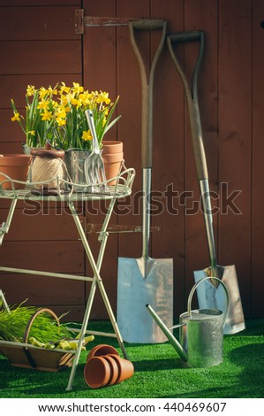 Gardening concept with utensils in front of garden shed - vintage feel - stock photo