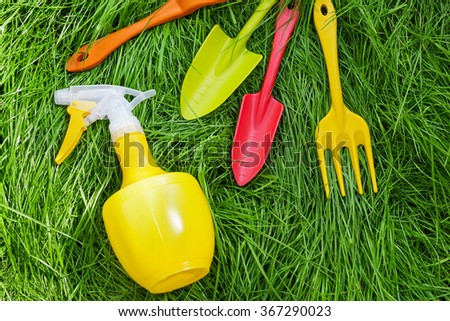 Gardening equipment on green grass - stock photo