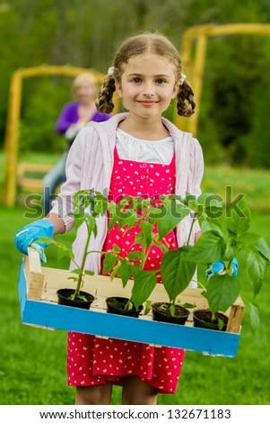 Gardening, garden, planting concept - lovely gardener working with mother in the garden - stock photo