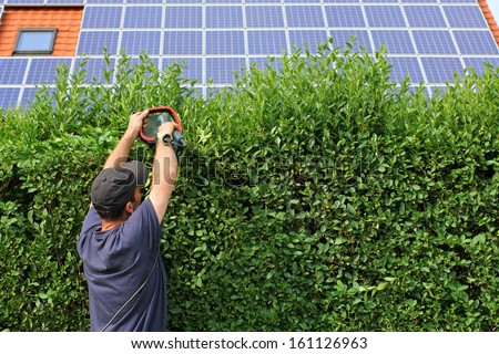 Gardening, house with solar moduls - stock photo
